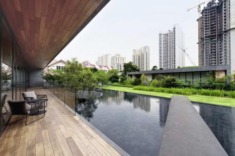 Дом с зелёной крышей в Сингапуре