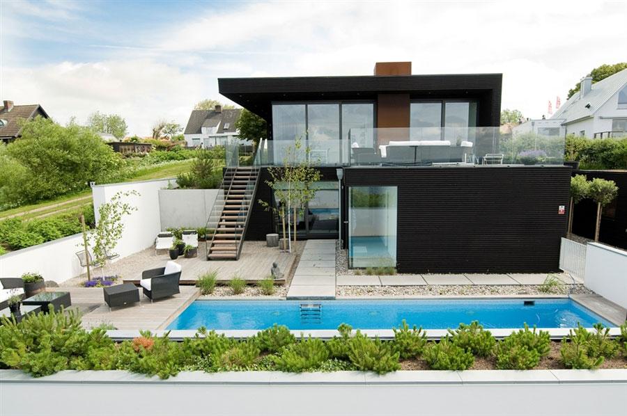 Проекты домов с балконом с фото