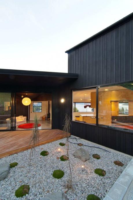 Дом с видом на озеро в Новой Зеландии