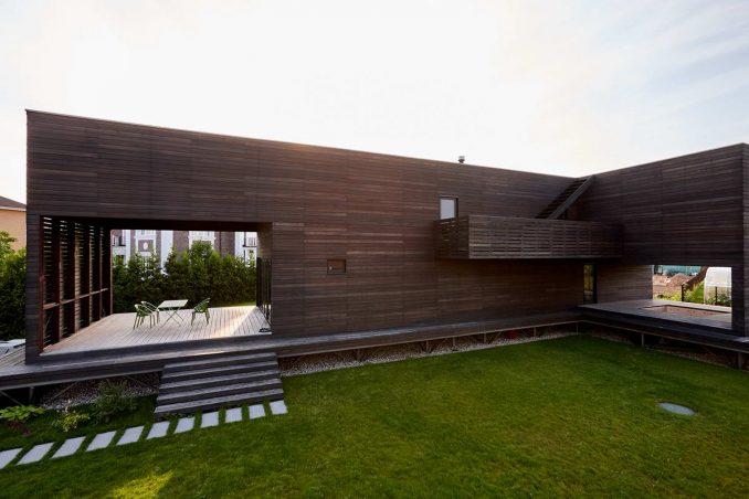 Парящий деревянный дом в стиле минимализм